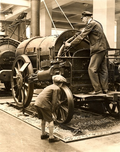 Schoolboy inspects the Rocket locomotive, 1929